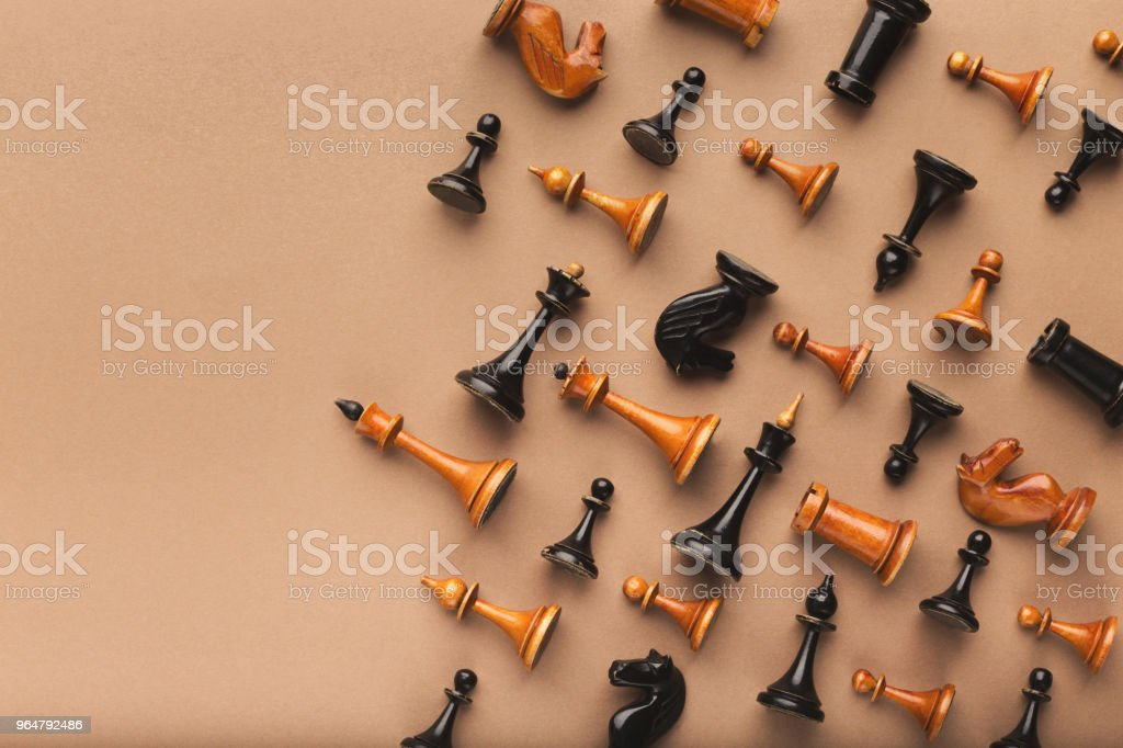Chess figures on beige table background royalty-free stock photo