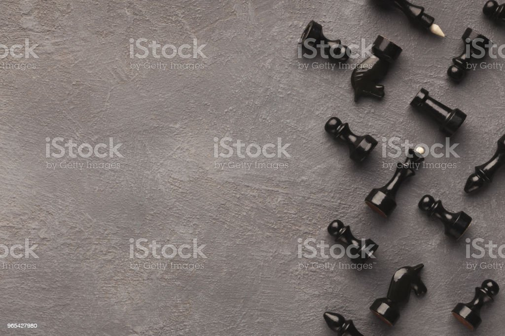 Chess figures on gray table background royalty-free stock photo
