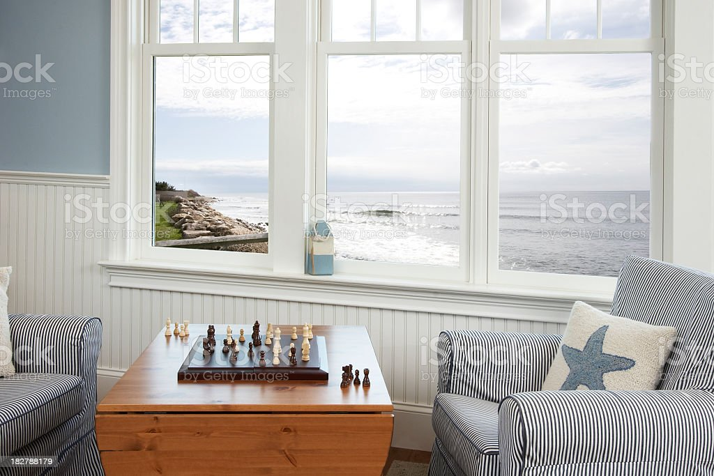 Chess game by the ocean stock photo