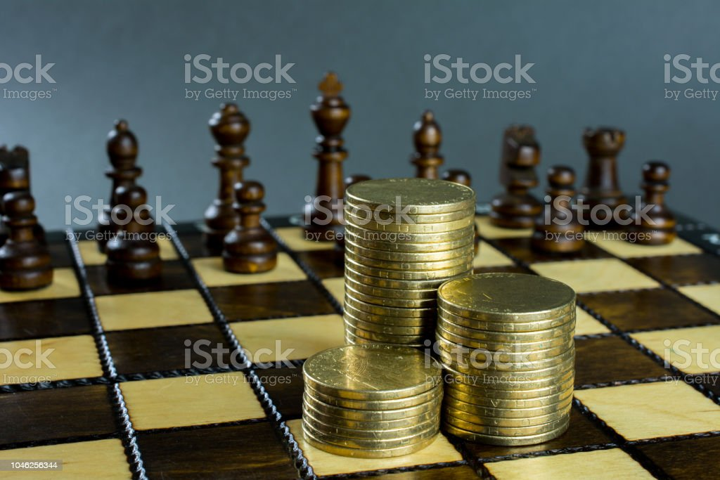 Chess Game Chess Board With Placed Figures Piles Of Gold Coins Stock Photo  - Download Image Now