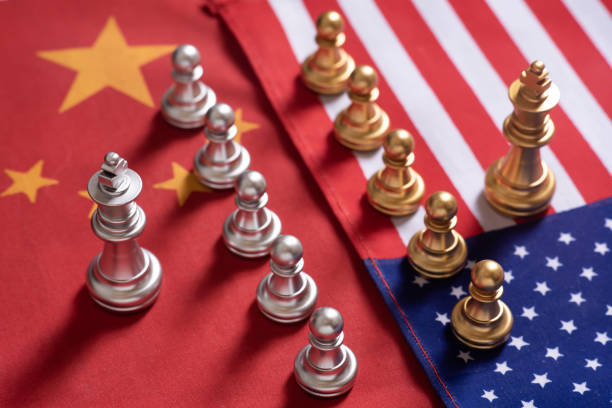 Chess game. Two team stand confront each other on China and USA national flags. Trade war concept. Copy space. Chess game. Two team stand confront each other on China and USA national flags. Trade war concept. Copy space. trade war stock pictures, royalty-free photos & images