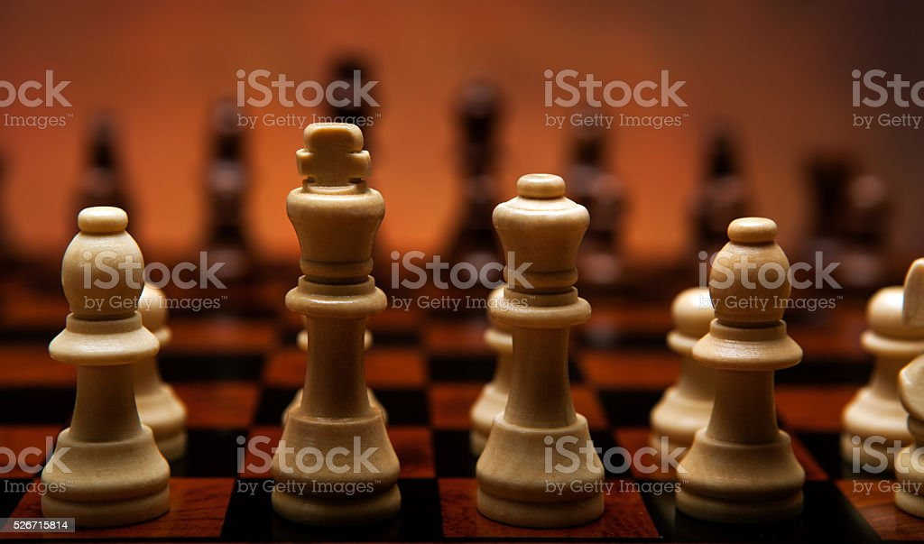 chess game with pieces on the board stock photo