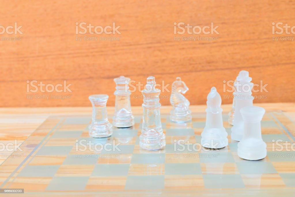 chess glass on board game. On a vintage wooden floor background...