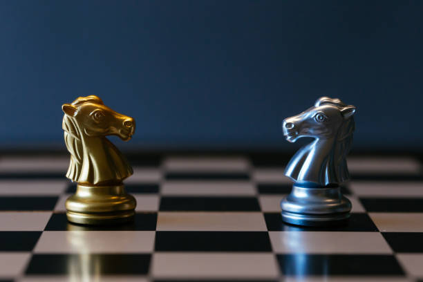Chess horse knights against each other on board stock photo