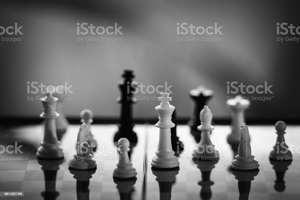 Chess on a Board of wood. bokeh nature background. game, strategy,...