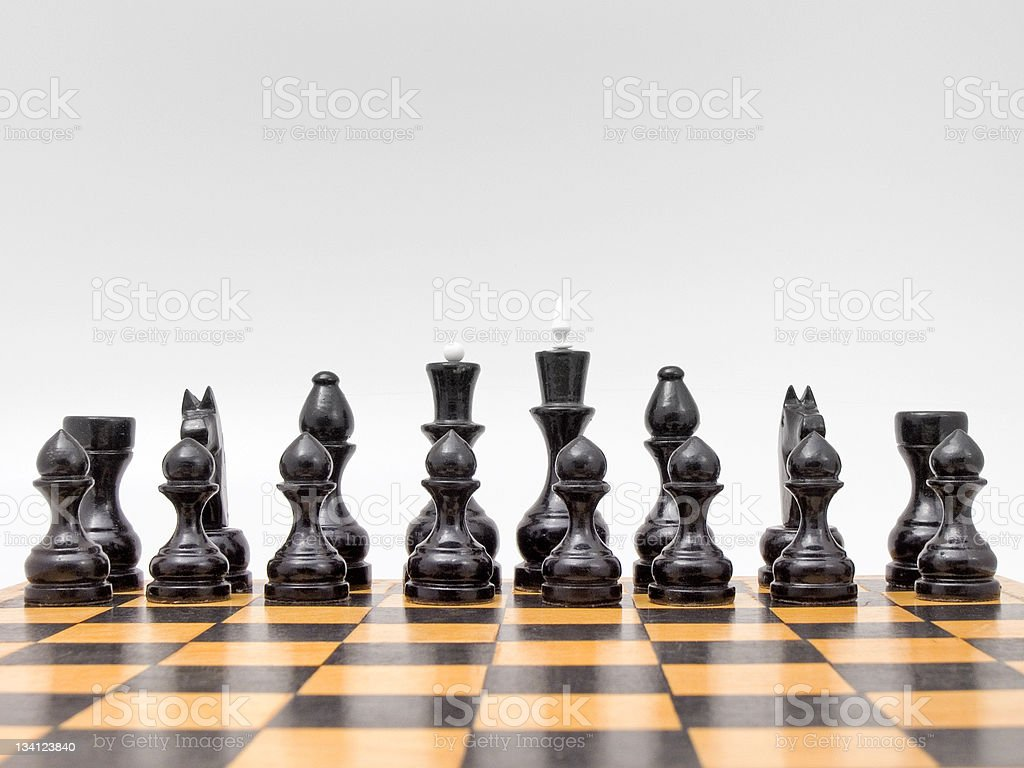 Chess on the grey background (isolated). stock photo