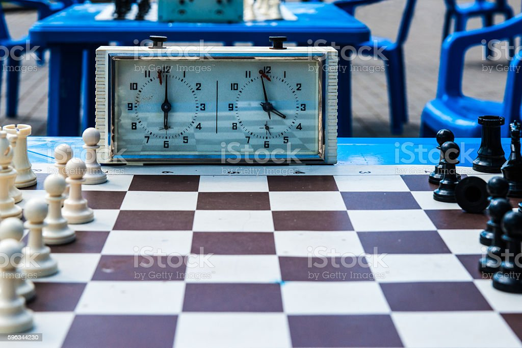 Chess pieces and chess clock Lizenzfreies stock-foto