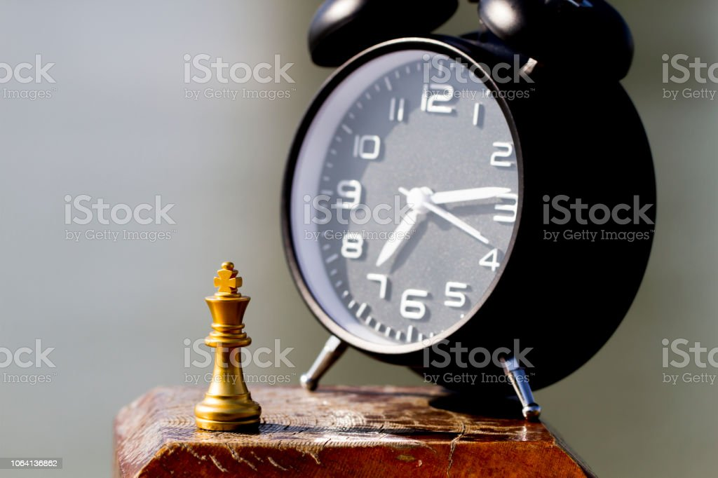 The outdoor alarm clock and time represent the preciousness of time.