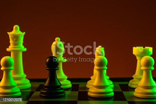 istock Chess pieces, Black pawn white pieces of silver on a chessboard, game. Concept of spy, espionage, confrontation, career, competition, startup, brain battle. 1210012073