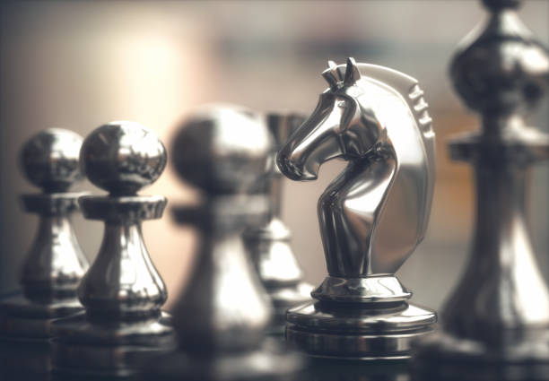 chess pieces chessboard - approach stock photos and pictures