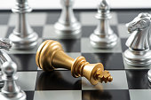 istock Chess pieces, death of a king,piece laying on the ground below. 1272905515