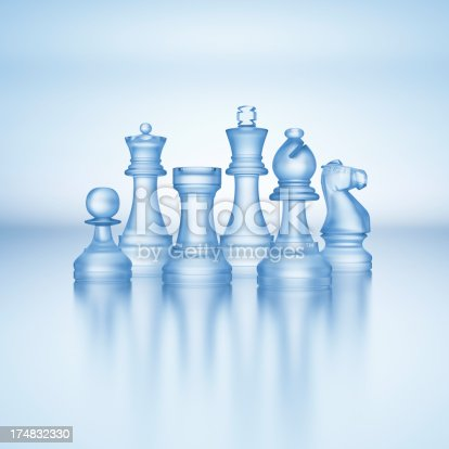 Glass chess pieces, king, queen, knight, bishop, rook and pawn.