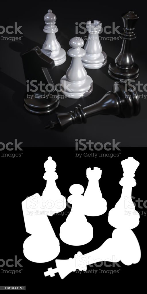 Chess pieces on a dark background stock photo