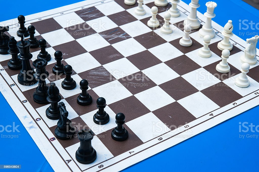 Chess pieces on a paper chess board royalty-free stock photo