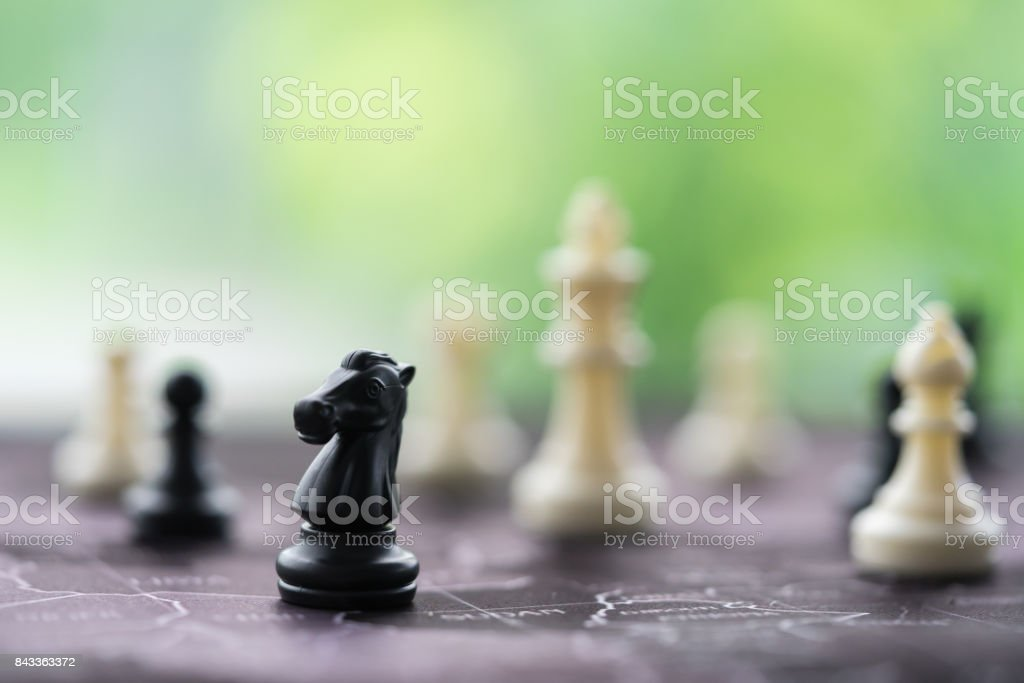 Chess pieces on board, business strategy stock photo