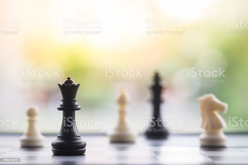Chess pieces on chess board, business strategy stock photo