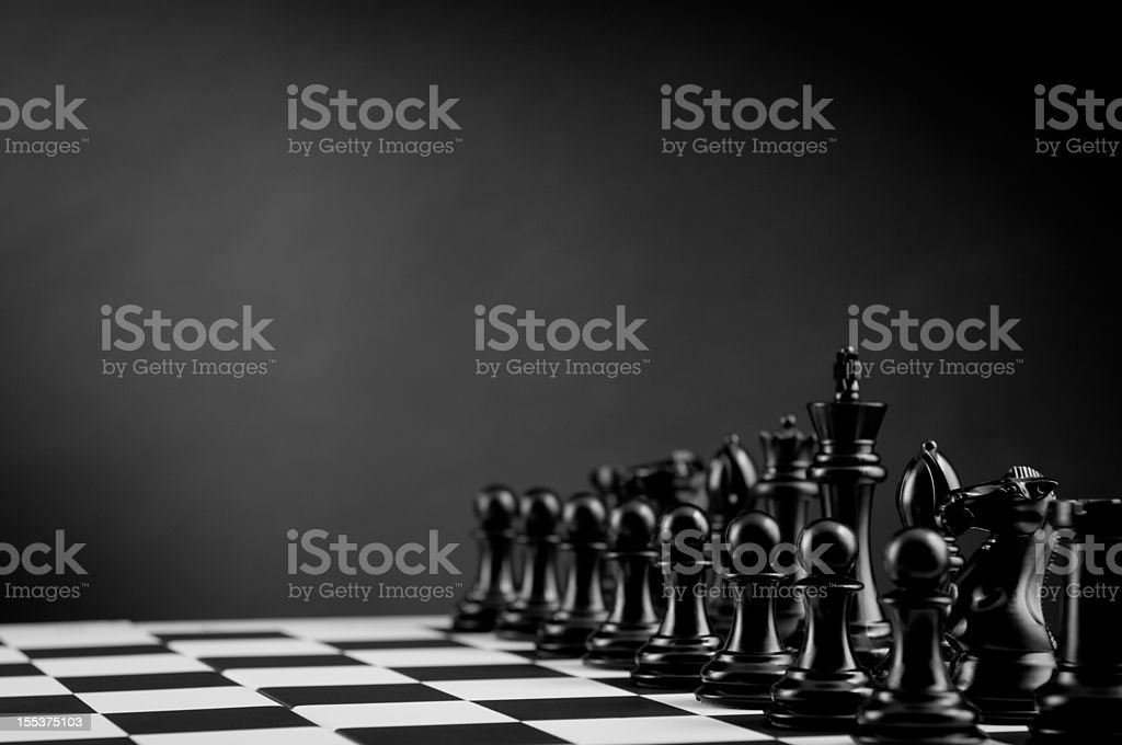 Chess pieces on chess board in black and white royalty-free stock photo