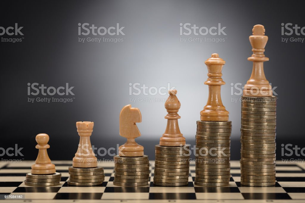 Chess Pieces On Stacked Golden Coins Stock Photo More Pictures Of