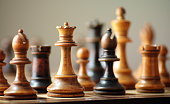 Zoom photograph of chess pieces on a chess board.