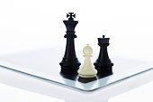 istock Chess pieces standing on the digital tablet 846034140