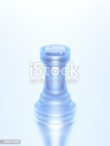 Chess rook made of glass on high key background.