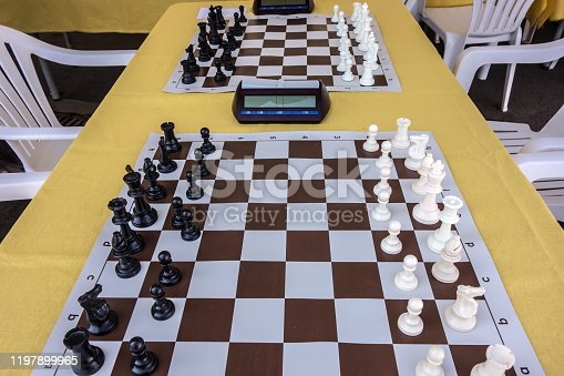 Chess tournament. Hall with prepared tables on which chess boards with clock are laid out, before the start of the competition. Learning concept. Education.