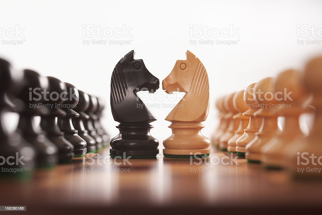 chess two rows of pawns with knight challenge centre stock photo