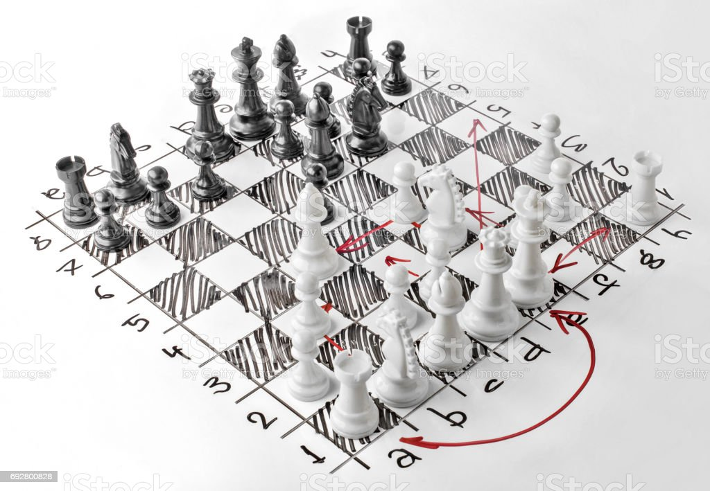 Chess. White board with chess figures on it. Plan of battle. stock photo