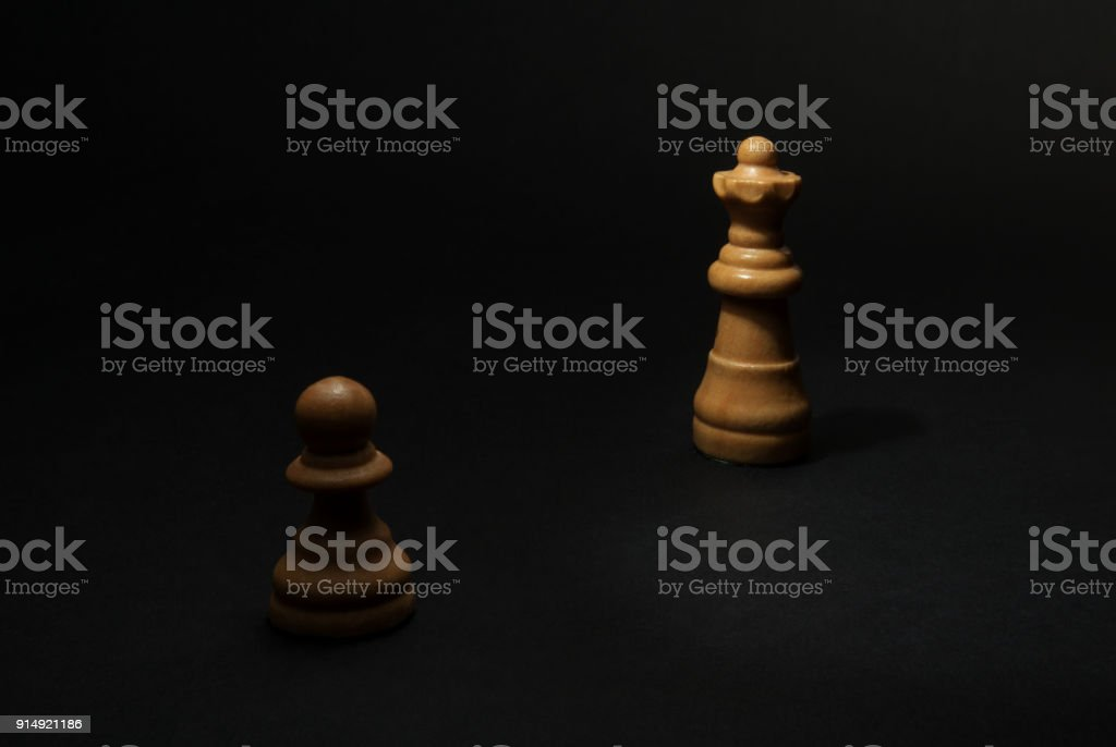 Chess. White Pawn and Queen. stock photo