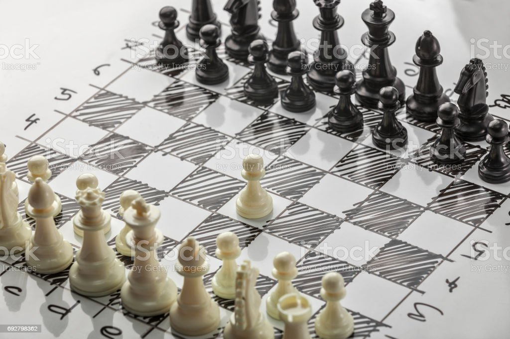 Chess. Whites are starting. White board with chess figures on it. Plan of battle. stock photo