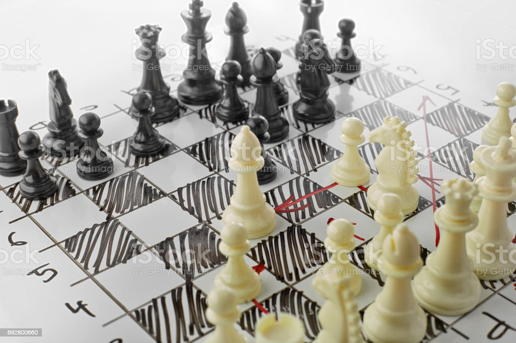 Chess, white's attack. White board with chess figures on it. Plan of battle. stock photo
