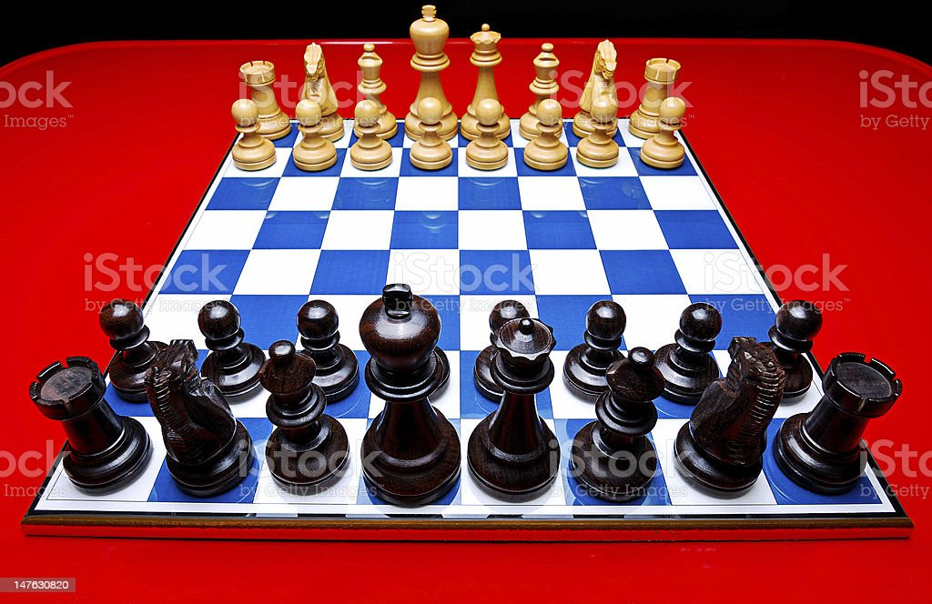 Chessboard on Red Table royalty-free stock photo