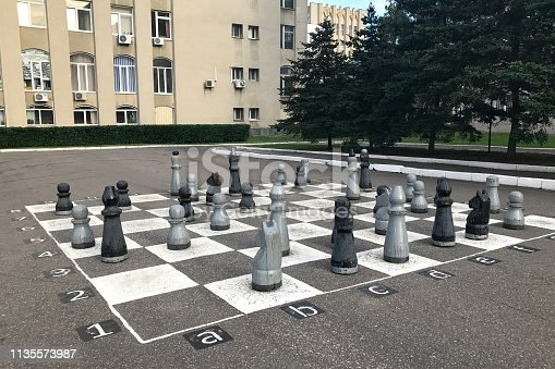 istock Chessboard painted on asphalt and chess pieces in Penza, Russia 1135573987