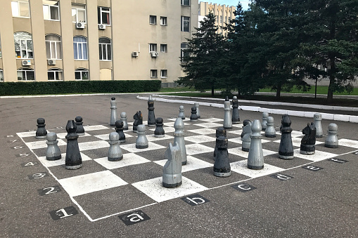 Chessboard painted on asphalt and chess pieces in Penza, Russia