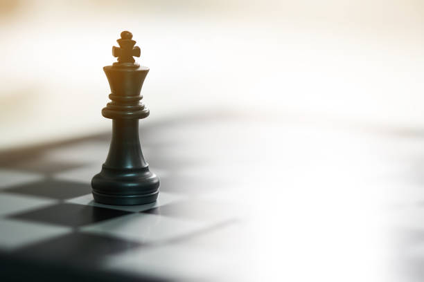 chessboard with a chess piece on the back negotiating in business. as background business concept and strategy concept with copy space. - xadrez imagens e fotografias de stock