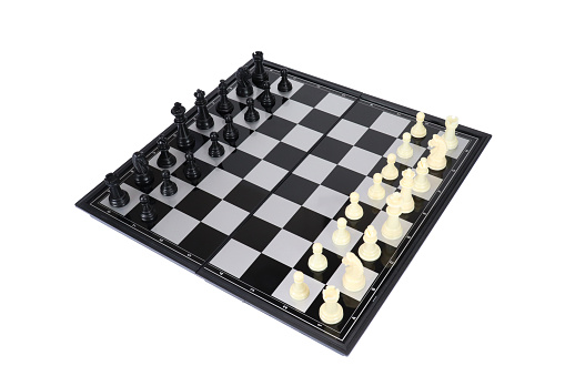 Chessboard with white and black pieces. On a white background, isolated.