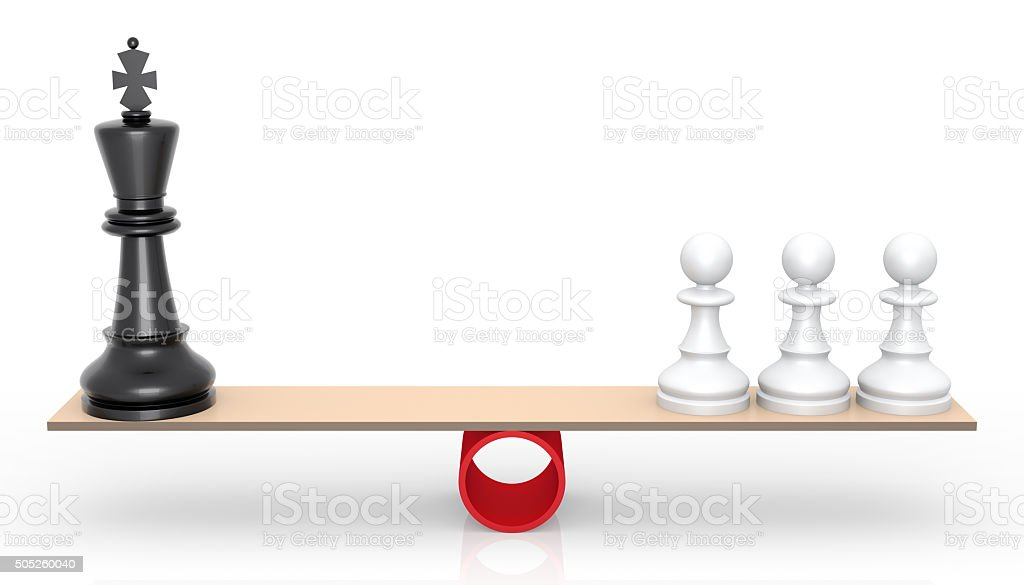 Chessmen on scales. The rivalry concept stock photo