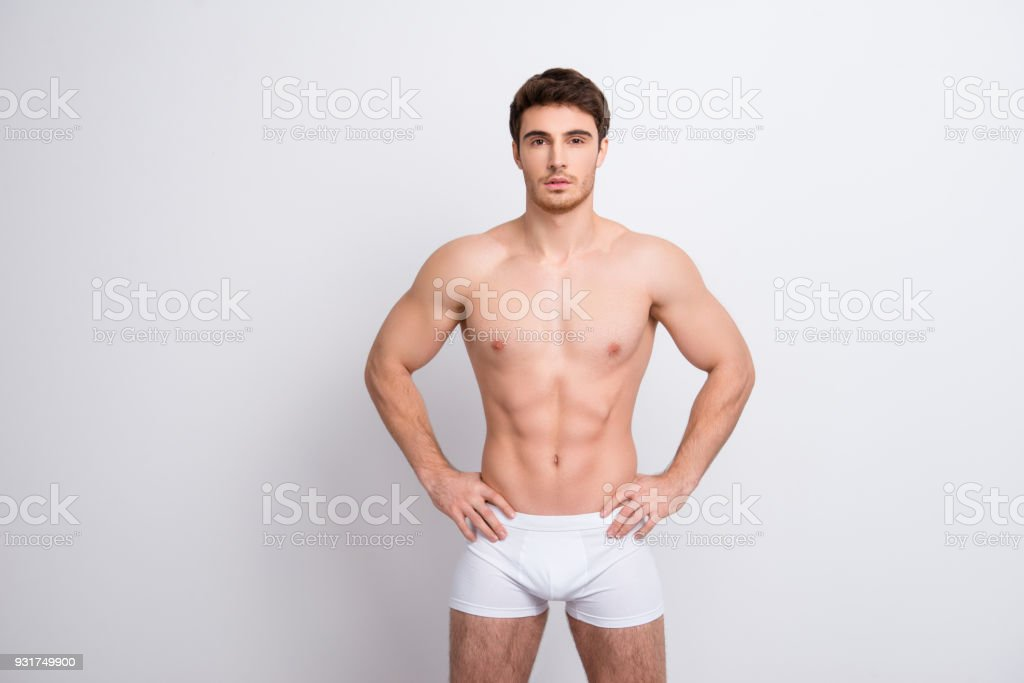 Chest clean clear people person concept. Portrait of handsome muscular virile masculine with abs six-pack sportsman holding hands on waist-line clothed in white underpants isolated on white background – zdjęcie