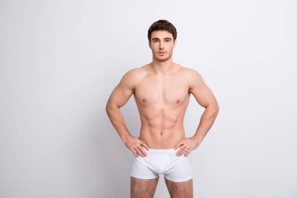 Chest clean clear people person concept. Portrait of handsome muscular virile masculine with abs six-pack sportsman holding hands on waist-line clothed in white underpants isolated on white background Chest clean clear people person concept. Portrait of handsome muscular virile masculine with abs six-pack sportsman holding hands on waist-line clothed in white underpants isolated on white background shirtless male models stock pictures, royalty-free photos & images