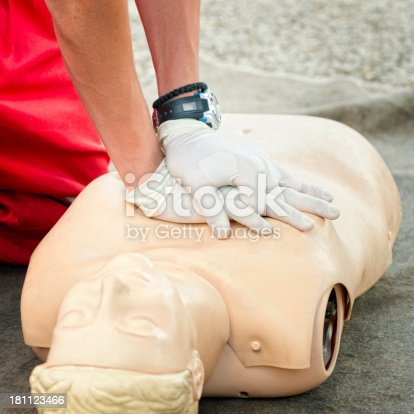 CPR chest compression - demonstration on dummy doll