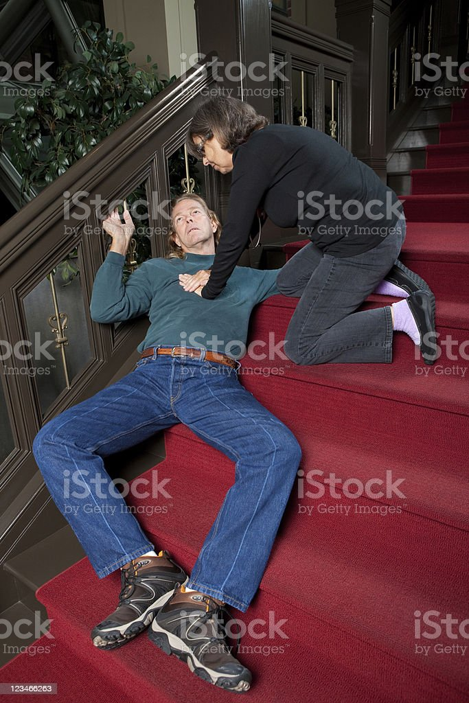 Chest Compressions on heart attack victim stock photo