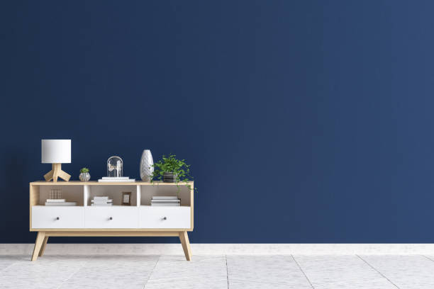 Chest of drawers in living room interior, dark blue wall mock up background stock photo