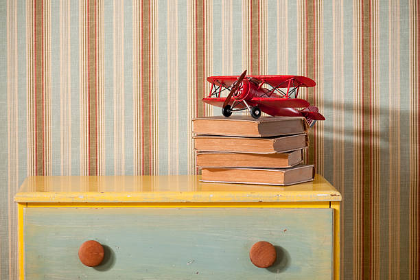 Chest Of Drawers With Books in Empty Bedroom stock photo