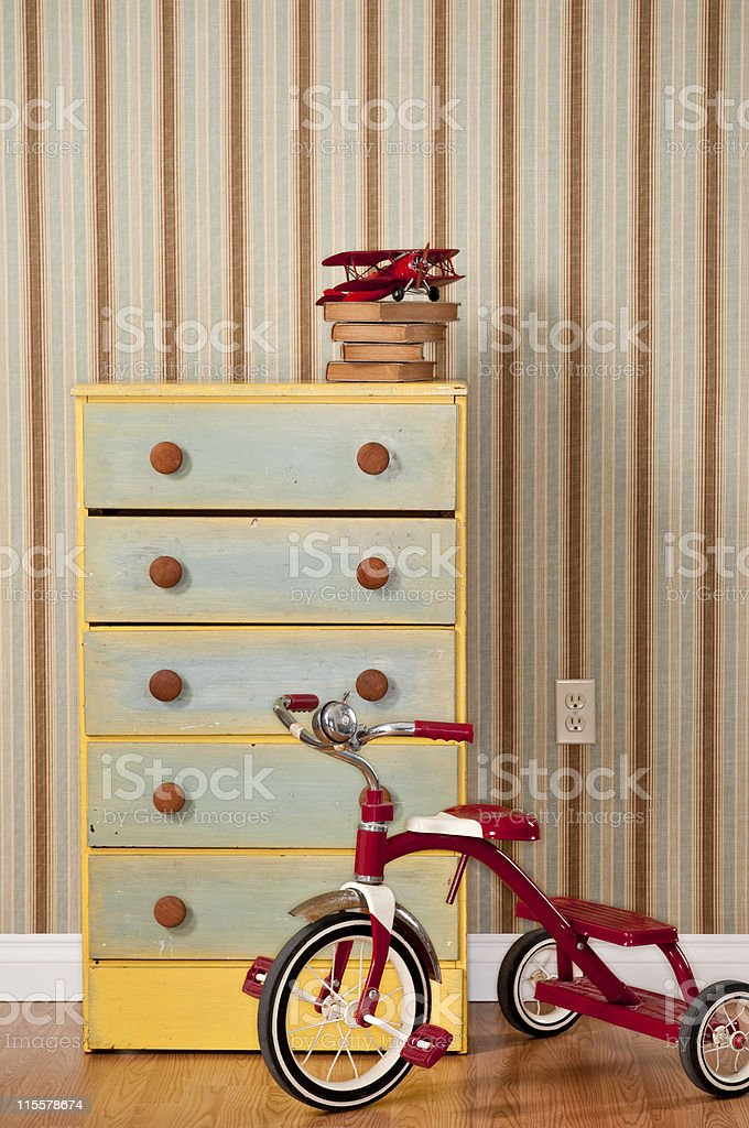Chest Of Drawers With Red Tricycle royalty-free stock photo