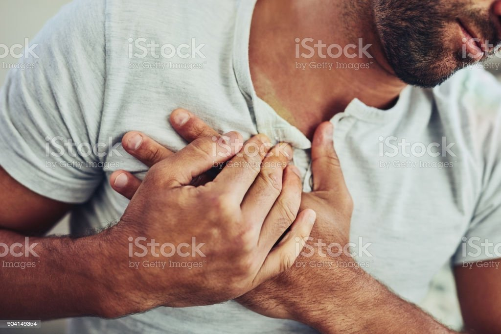 Chest pain is the worst! stock photo