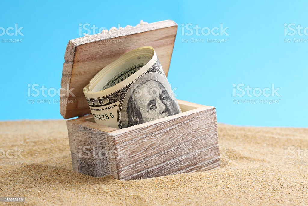 Chest with money american hundred dollar bill on a beach stock photo