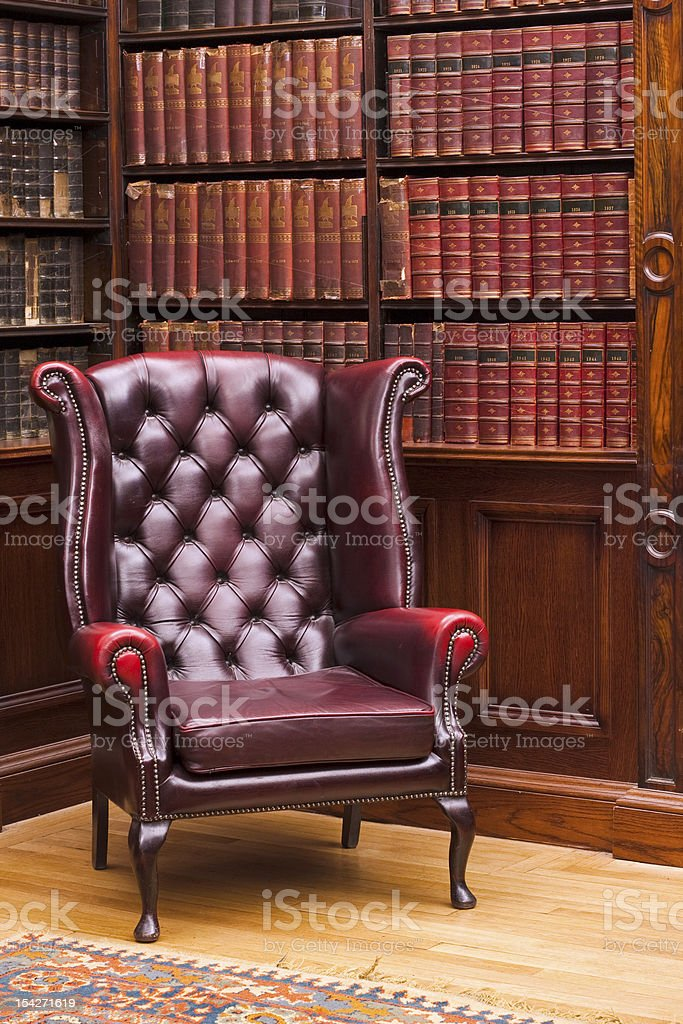 Chesterfield chair in the library stock photo