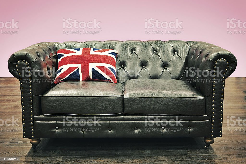 Chesterfield couch with union jack cushion royalty-free stock photo