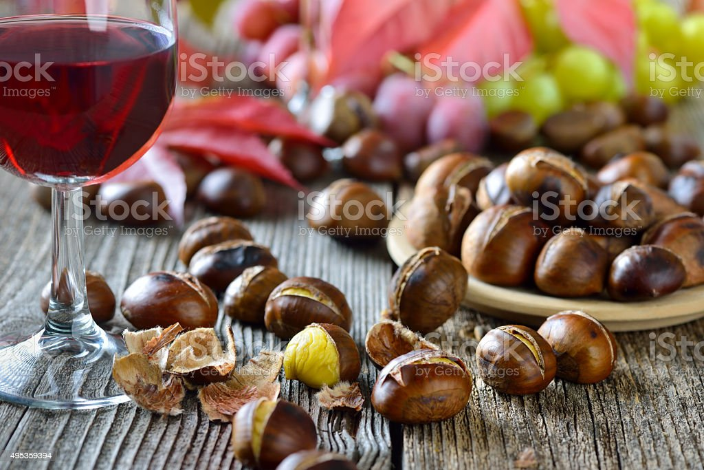 Chestnuts and wine stock photo