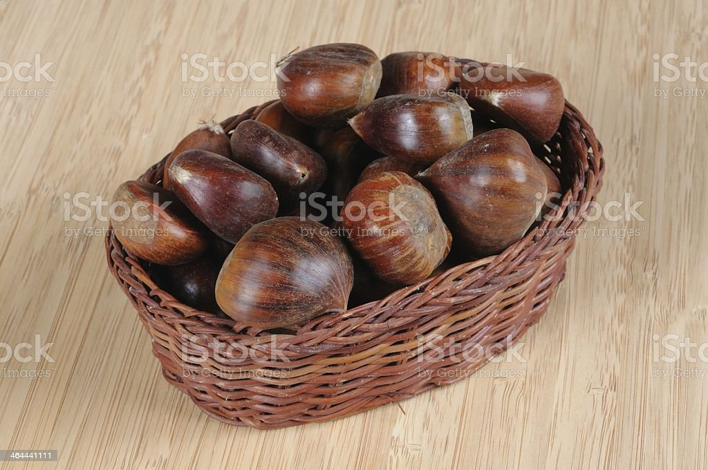 Chestnuts in wicker basket. royalty-free stock photo
